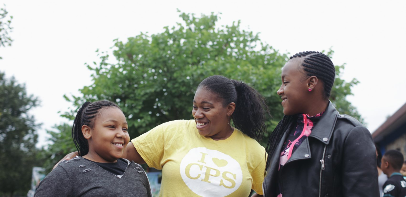 Sisters Kayla (left) and Kiarra Sils, seen here with their mom, say they're excited to visit the Discovery Center. (Neal Santos for PlanPhilly)