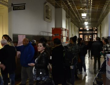Voters formed a long line in Philadelphia City Hall last week to get their absentee ballots. (Tom MacDonald/WHYY)