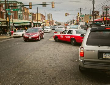 Traffic on Washington Avenue in South Philadelphia, one of the corridors targeted for improvements in new city plan. (Neal Santos)