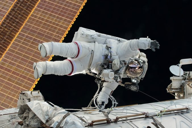 Kelly waving at the camera on his 3rd and final space walk (courtesy of NASA)