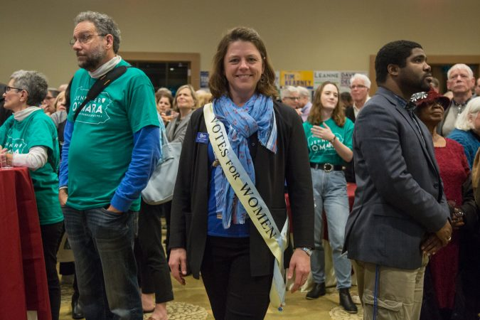 Bonny Hodges, a Delco Democrats  committeewoman for Springfield, shows how she votes on her sash at the official watch party for Mary Gay Scanlon in Swarthmore, Pa. on November 6, 2018. (Emily Cohen for WHYY)