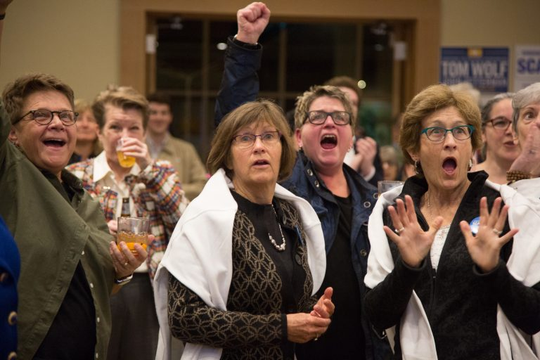 Frankie Franceschini, Linda McCarthy, Bonnie Shuman, and Sandy McCarthy (left to right) react as results come in for the 2018 midterm elections November 6th 2018 in Swarthmore, PA. (Emily Cohen for WHYY)