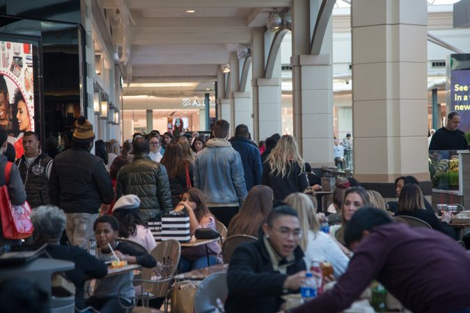 Shoppers pass around the crowds of the food court as others take a lunch break on Black Friday at the King of Prussia Mall in Pennsylvania November 23rd 2018. (Emily Cohen for WHYY)