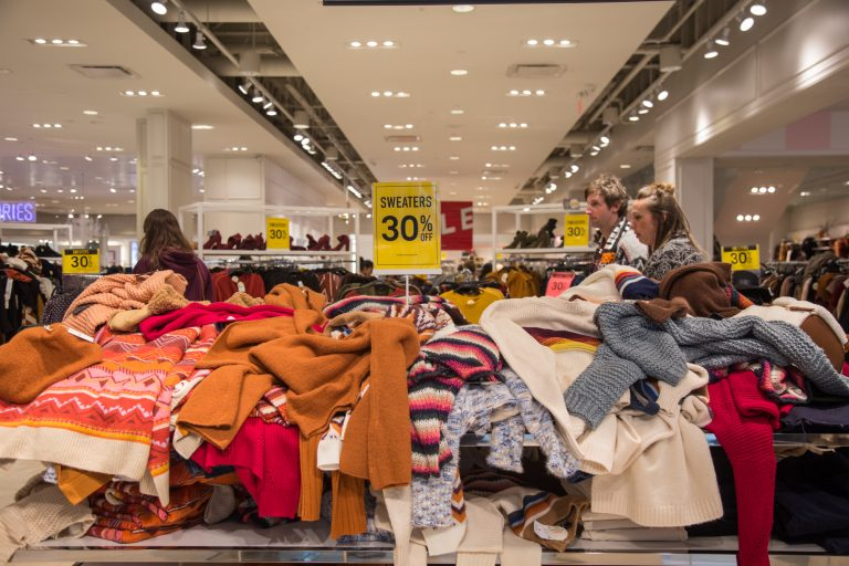 Sweaters are strewn about at Forever 21 on Black Friday at the King of Prussia Mall. (Emily Cohen for WHYY)