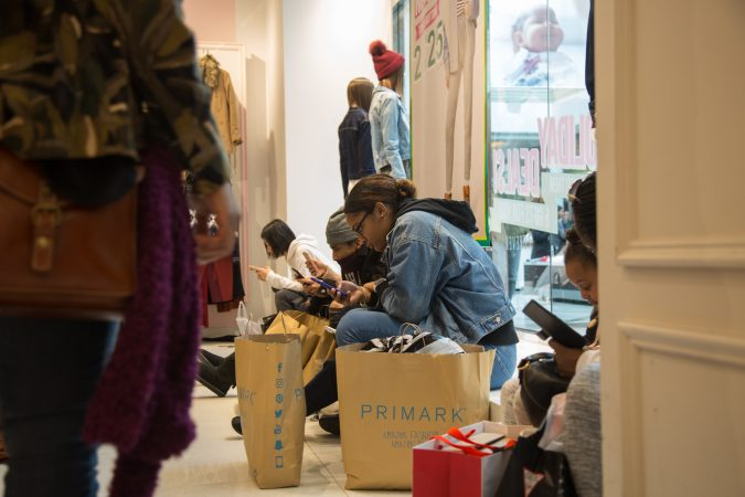 Shoppers take a break from shopping on Black Friday at the King of Prussia Mall in Pennsylvania November 23rd 2018. (Emily Cohen for WHYY)
