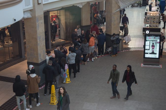 Shoppers line up for thir oppurtunity to shop at ADIDAS on Black Friday at the King of Prussia Mall in Pennsylvania November 23rd 2018. (Emily Cohen for WHYY)
