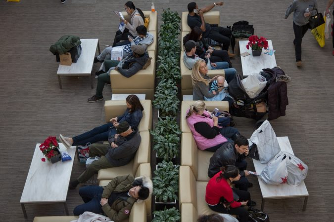 Shoppers take a break from the crowds and shopping on Black Friday at the King of Prussia Mall in Pennsylvania November 23rd 2018. (Emily Cohen for WHYY)