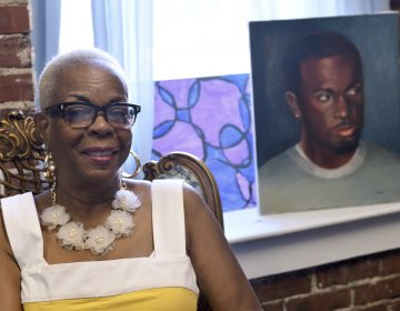 Dorothy Johnson-Speight, founder of Mothers in Charge, sitting before a painting of her murdered son, Khaliiq Jabbar Johnson. (Bastiaan Slabbers for Keystone Crossroads)