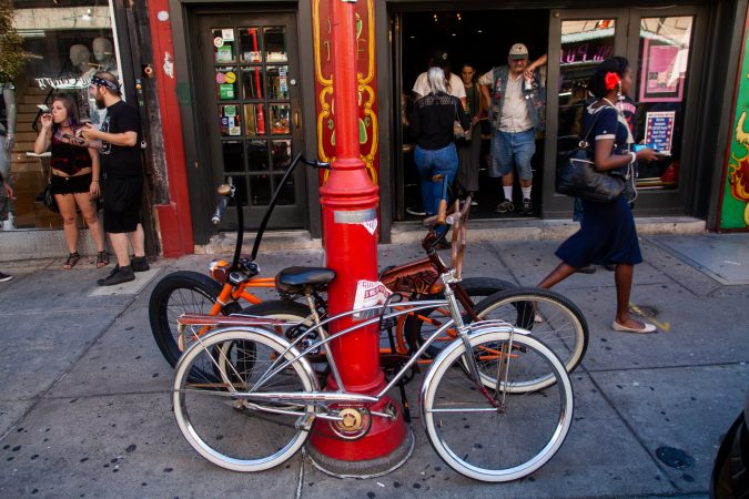 Some Jersey Devils keep a watchful eye on their rides outside of Tattooed Moms (Brad Larrison for WHYY)