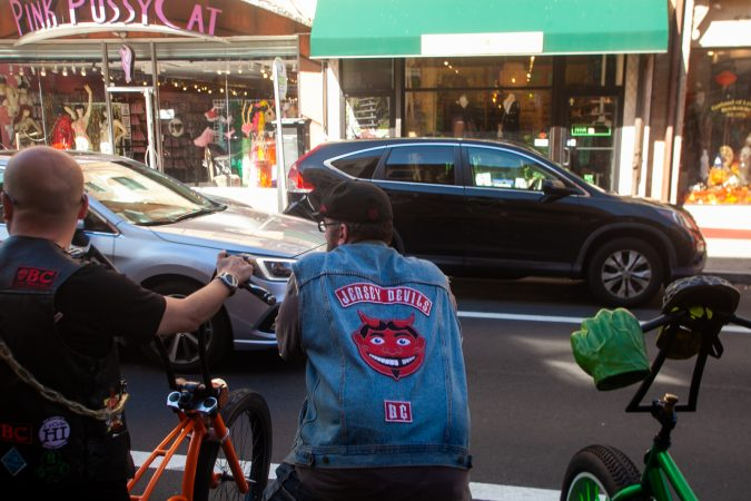 Jersey Devils talk to curious passerbys on South Street (Brad Larrison for WHYY)