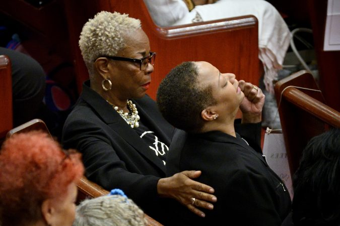 Dorothy Johnson-Speight, founder and executive director of Mothers in Charge, comforts a member of the group during a service at Enon Tabernacle Baptist Church. (Bastiaan Slabbers for Keystone Crossroads)