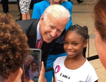 Joe Biden poses for a selfie with a young fan. (Delaware's Joe Biden/WHYY)