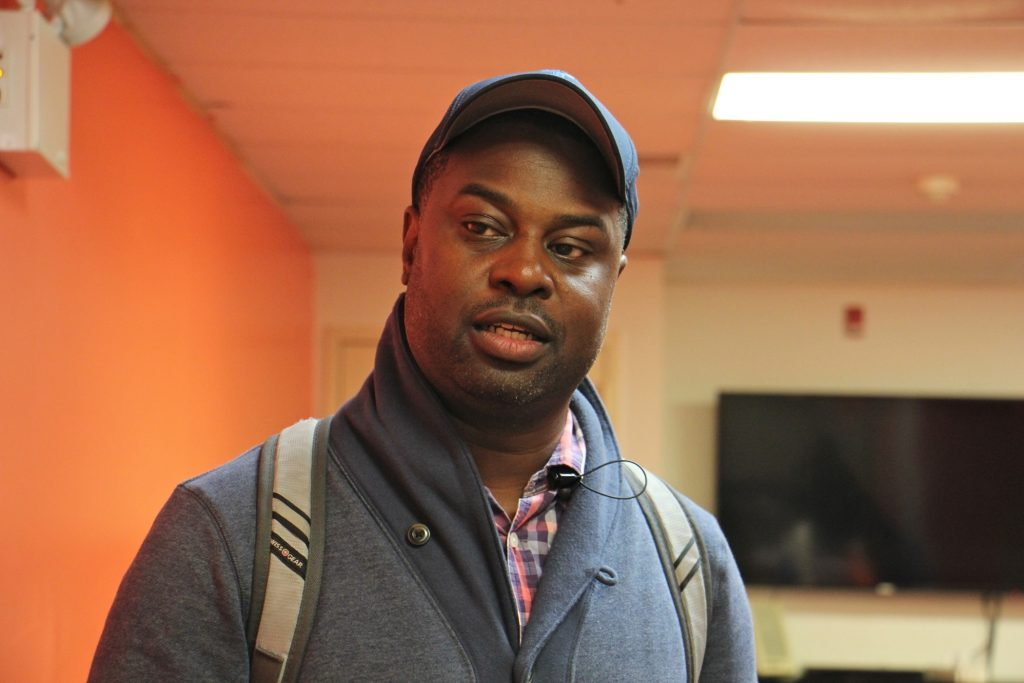 Joseph Douglas of Black Men Assisting Black Boys Alliance attends a meeting  at The Bridge in West Philadelphia. (Emma Lee/WHYY)