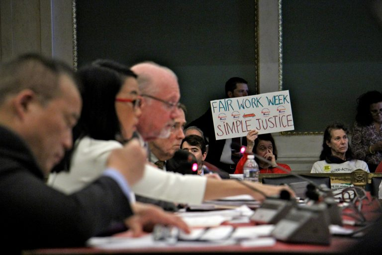 Supporters attend a hearing at Philadelphia City Hall on fair workweek legislation. (Emma Lee/WHYY)