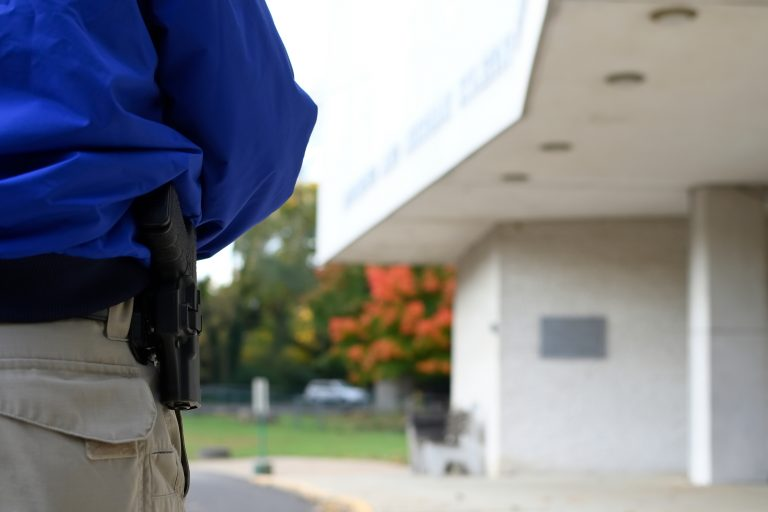Security guard Donald Mee stands near the entrance of Congregation Adath Jeshurun, in Elkins Park, on Wednesday, Oct. 31, 2018. (Bastiaan Slabbers for WHYY)