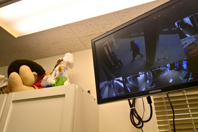 Security guard Donald Mee is seen at the front door on a monitor In the main office at Congregation Adath Jeshurun, in Elkins Park, on Wednesday, Oct. 31, 2018. (Bastiaan Slabbers for WHYY)