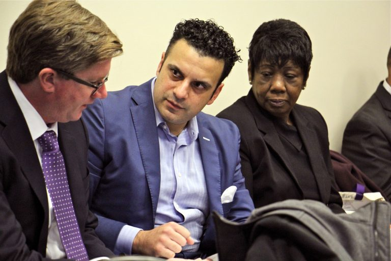 Developer Rahil Raza and Vivian VanStory consult with attorney Paul J. Toner during a Philadelphia zoning board meeting. (Emma Lee/WHYY)