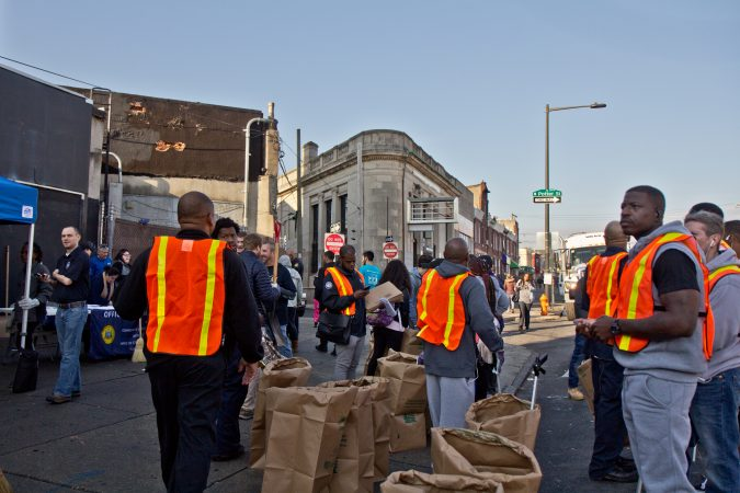 Philadelphia city workers and community groups work to clean up the streets of Kensington. (Kimberly Paynter/WHYY)