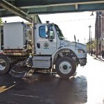 A street sweeper works along Kensington Avenue