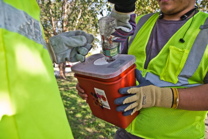 City workers and community groups work to clean up McPherson Square and the area around it, including disposing of used needles. (Kimberly Paynter/WHYY)