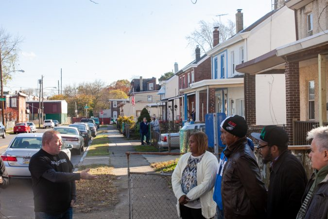 Pete Smith, President of the Tacony Civic Association, spoke at a gathering for the Mella family who recently received a racist and threatening letter after moving into the neighborhood. (Brad Larrison for WHYY)