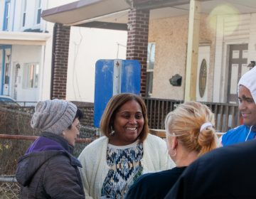 Connie Mella and her son Elvis were greeted by Tacony residents who came to show support for the family on Saturday after they received racist and threatening mail earlier this month. (Brad Larrison for WHYY)