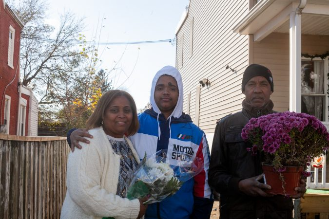 The Mella family outside of their home in the Tacony section of Philadelphia. (Brad Larrison for WHYY)