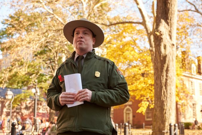 Paul Campbell, a park ranger at Independence National Historical Park in Philadelphia leads the bell ringing ceremony to commemorate the centennial of Armistice Day on Nov. 11, 2018. (Natalie Piserchio for WHYY)