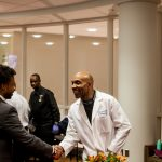 Anesthesiologist Kevin Guynn M.D greets a pre-med student at Temple University's An Evening with Black Men in Medicine event. (Brad  Larrison for WHYY)