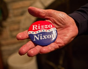 Frank Rizzo Jr. holds a campaign button with the Nixon/Rizzo ticket. (Kimberly Paynter/WHYY)