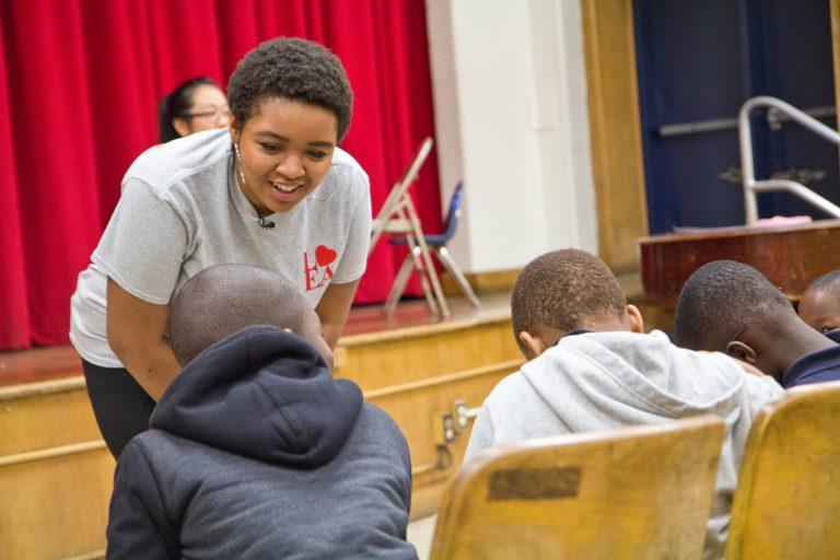 Anea Moore teaches choir to kids at Henry Lea Elementary school. The Philadelphia woman has won a Rhodes scholarship. (Kimberly Paynter/WHYY)