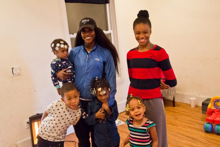 Ricci Rawls and her children, Patience, 12, Charlie, 7, Izzy, 5, Ava 4, and Faith, 1 on their last day before eviction. (Kimberly Paynter/WHYY)