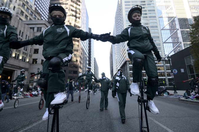 Woodside One Wheelers (WOW) of Woodside Elementary School from Topsham, Maine takes part in the 99th annual Thanksgiving Day Parade, in Center City Philadelphia. (Bastiaan Slabbers for WHYY)
