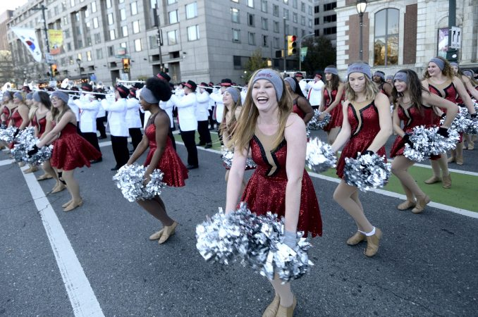 Cheerleaders and drum bands try to keep warm during the 99th annual Thanksgiving Day Parade, in Center City Philadelphia. (Bastiaan Slabbers for WHYY)