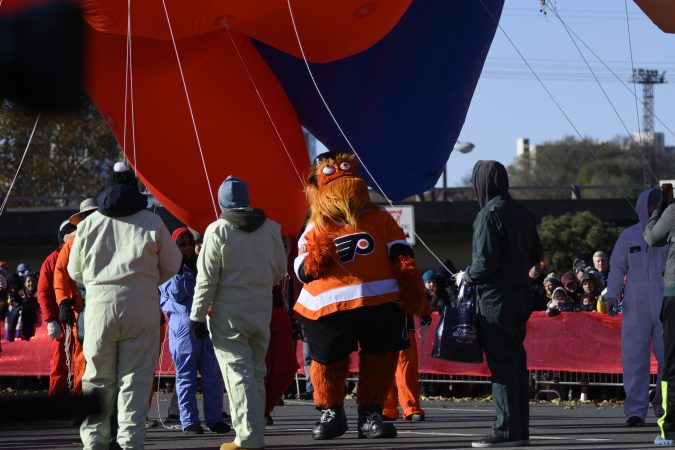 Gritty helps balloon handlers during the 99th annual Thanksgiving Day Parade in Center City Philadelphia. (Bastiaan Slabbers for WHYY)