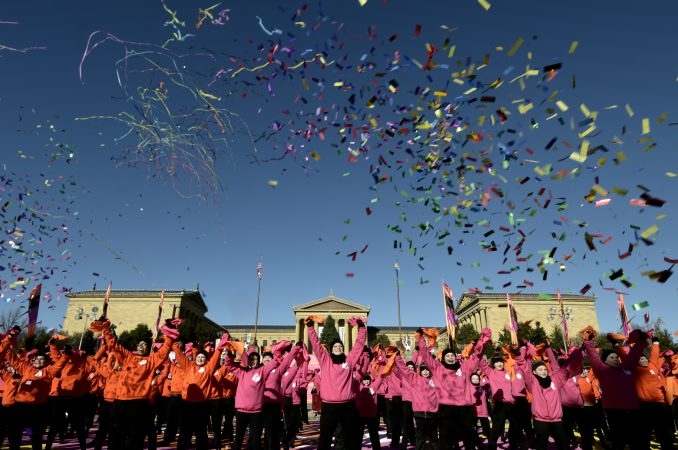 Streamers fill the sky in front of the Art Museum steps as performers take part in the televised component of the 99th annual Thanksgiving Day Parade. (Bastiaan Slabbers for WHYY)