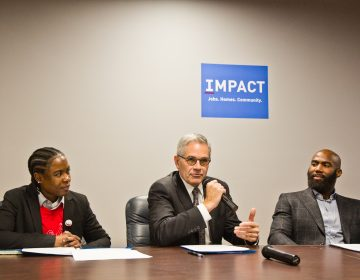 "Philadelphia District Attorney Larry Krasner speaks at a ""No Cash Bail"" event with bail navigator LaTonya Myers and Eagles safety Malcolm Jenkins.(Kimberly Paynter/WHYY)"
