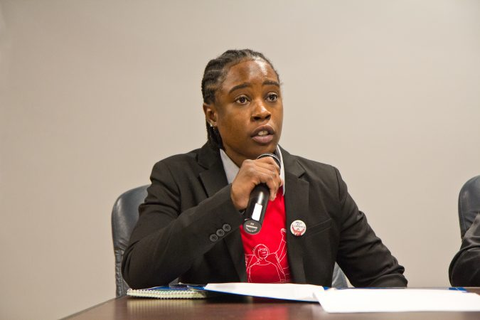 LaTonya Myers spent nine months in prison because she couldn't afford to post bail before she was acquitted at trial. She now works for the Defender Association of Philadelphia as a bail navigator. (Kimberly Paynter/WHYY)
