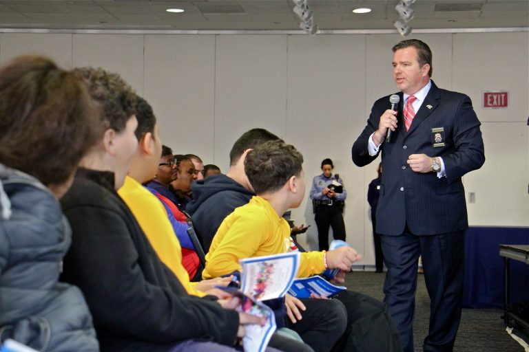 Shawn Ellerman, of the Philadelphia Field Division of the Drug Enforcement Administration, speaks to Philadelphia school children during a youth summit on drug prevention at Temple University.