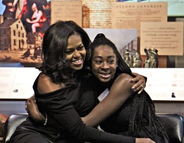Michelle Obama embraces Nariah, a Philadelphia high school sophomore, during a surprise visit to the African American Museum in Philadelphia. A dozen girls in the beGirl.world program, which encourages African American girls to travel, were treated to an intimate question and answer session with the former First Lady.