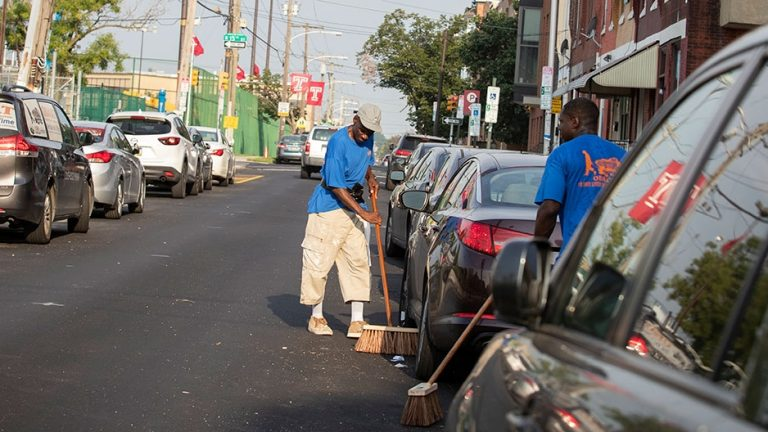 Three days each week, Bill Williams, left, and the crew from One Day at a Time clean up the community near Temple.