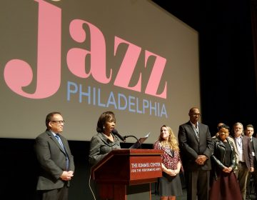 Philadelphia Councilwoman Blondell Reynolds Brown reads a resolution in support of Jazz Philadelphia at the opening of a jazz summit in the Kimmel Center. Councilman David Oh is at left. (Peter Crimmins/WHYY)