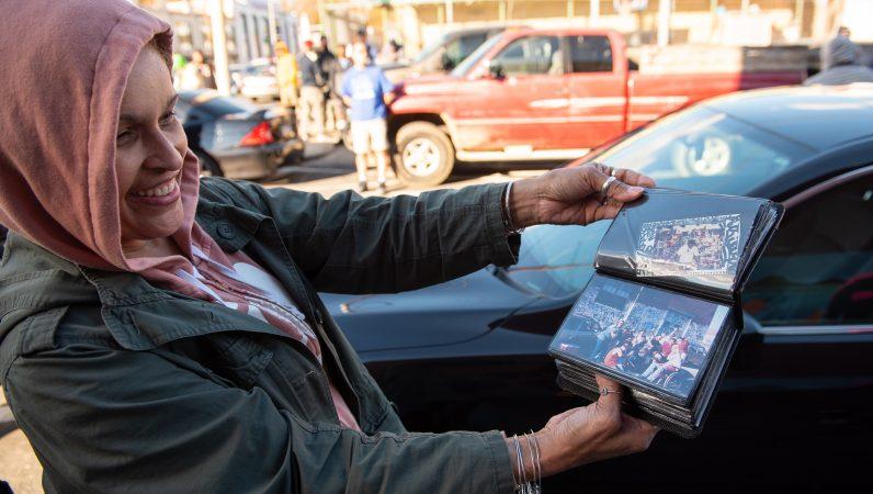 Migdalia Nazario, sister to the late graffiti writer Karaz, flips through photos of the Philadelphia legend on Saturday, November 3, 2018. (Kriston Jae Bethel for WHYY)