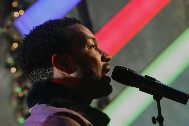 R & B singer John Legend performs a song as he tapes a segment for the Christmas day show of the NBC
