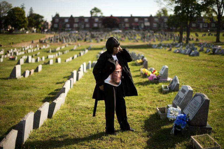 Dorothy Johnson-Speight visits the grave of her son, Khaaliq Jabbar Johnson, in Philadelphia on Monday, May 9, 2016. Johnson was killed in 2001 - shot seven times over a parking space dispute. (AP Photo/Matt Rourke)