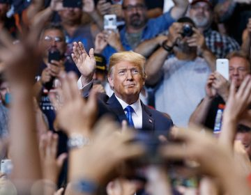 President Donald Trump waves to the cheering crowd as he arrives for a rally, Thursday, Aug. 2, 2018, at Mohegan Sun Arena at Casey Plaza in Wilkes Barre, Pa..