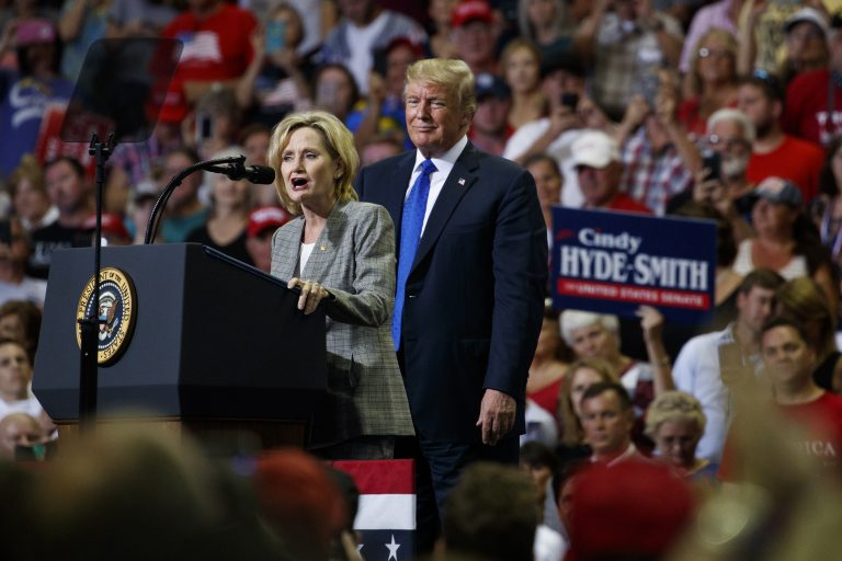 President Donald Trump watches as Sen. Cindy Hyde-Smith, R-Miss., speaks during a campaign rally at the Landers Center Arena, Tuesday, Oct. 2, 2018, in Southaven, Miss. (AP Photo/Evan Vucci)