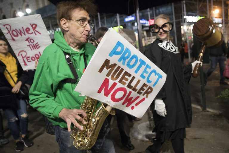 Protesters march through Times Square during a demonstration in support of special counsel Robert Mueller, Thursday, Nov. 8, 2018, in New York. A protest in New York City has drawn several hundred people calling for the protection of Mueller's investigation into potential coordination between Russia and President Donald Trump's campaign. (Mary Altaffer/AP Photo)