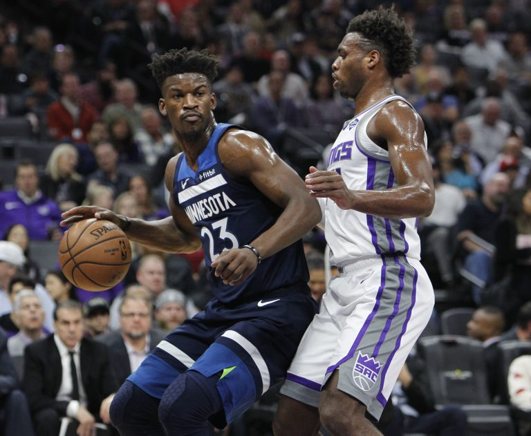 Minnesota Timberwolves guard Jimmy Butler (23) battles for position against Sacramento Kings guard Buddy Hield (24) during the first half of an NBA basketball game in Sacramento, Calif., Friday, Nov. 9, 2018. (Steve Yeater/AP Photo)