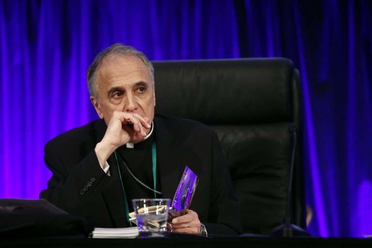 Cardinal Daniel DiNardo of the Archdiocese of Galveston-Houston, president of the United States Conference of Catholic Bishops, prepares to lead the USCCB's annual fall meeting, Monday, Nov. 12, 2018, in Baltimore. (Patrick Semansky/AP Photo)